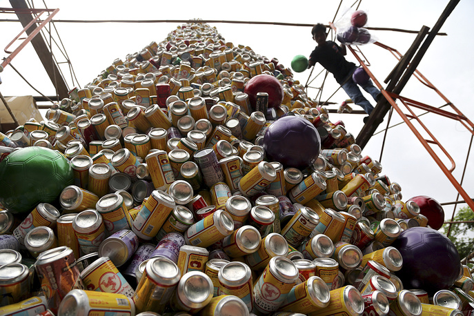 Christmas tree made of beverage cans in front of a church in Jakarta, Indonesia