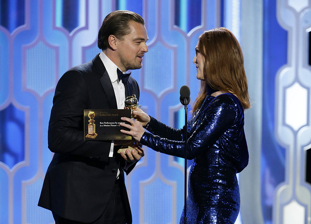"Julianne Moore presenting the award for best actor in a motion picture drama to Leonardo DiCaprio for his role in ""The Revenant,"" during the 73rd Annual Golden Globe Awards"