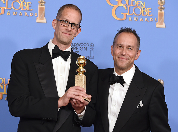 """Pete Docter and Jonas Rivera with the award for best motion picture - animated for """"Inside Out"""""""