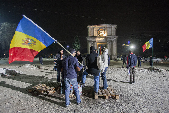 People gathering in front of the government building, during a protest in Chisinau