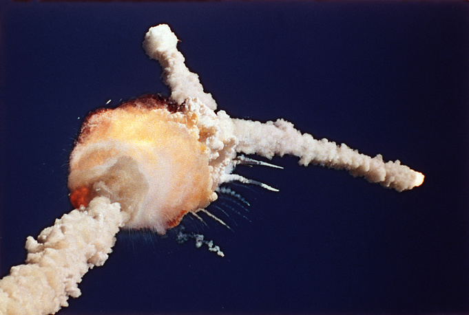 Space shuttle Challenger exploding shortly after lifting off from Kennedy Space Center, Jan. 28, 1986. All seven crew members died in the explosion. The shuttle had no escape system, and the impact of the crew compartment with the ocean surface was too violent to be survivable