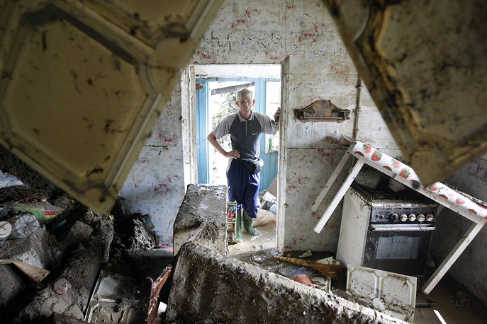 A flood victim inspecting his house in the town of Krymsk, 2012