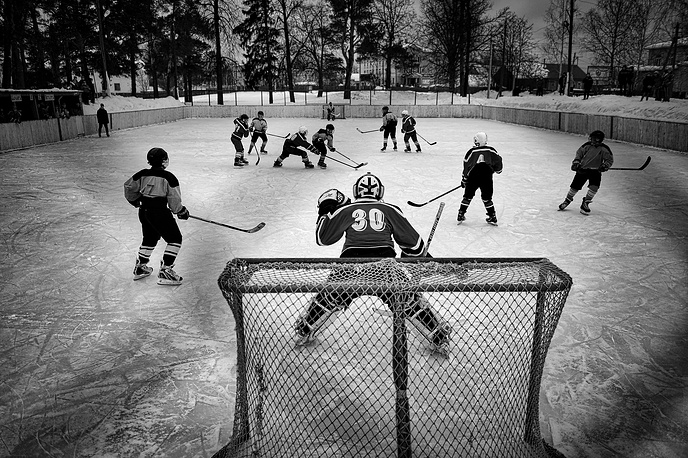 Russian photographer Vladimir Pesnya, First Prize Stories in the Sports Category.  The picture shows the match between junior teams from Vetluga and village Sharanga in Vetluga, Russia, 19 February 2015