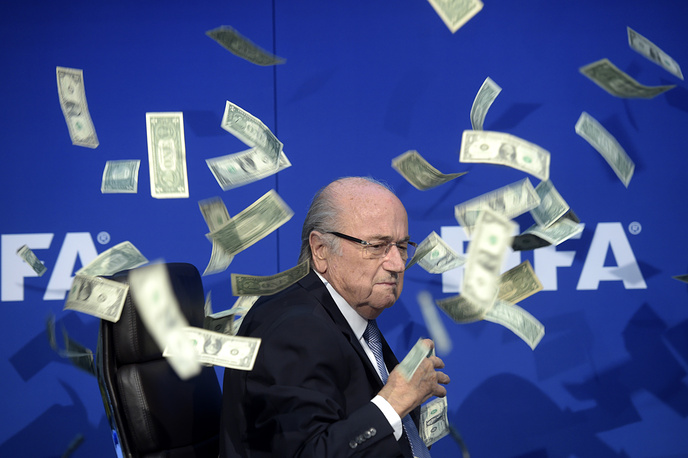 On May 29, 2015 Sepp Blatter was reelected for his fifth consecutive four-year FIFA presidential term. However later Blatter said he decided to lay down his mandate at FIFA extraordinary elective Congress. Photo: Sepp Blatter seen while banknotes thrown by British Comedian Simon Brockin hurtle through the air during a press conference following the extraordinary FIFA Executive Committee, 20 July 2015