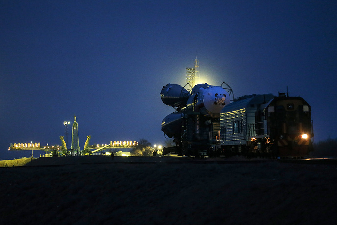 Russian Soyuz TMA-20M rocket booster is moved for installation at the launch pad at Baikonur