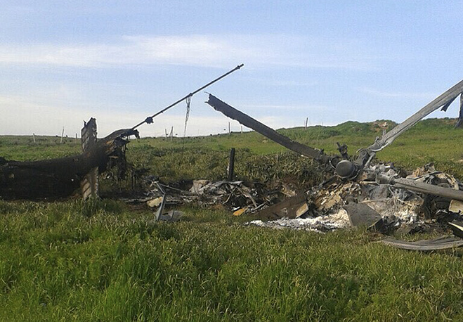 Remains of a downed Azerbaijani forces helicopter lies in a field in Nagorno-Karabakh