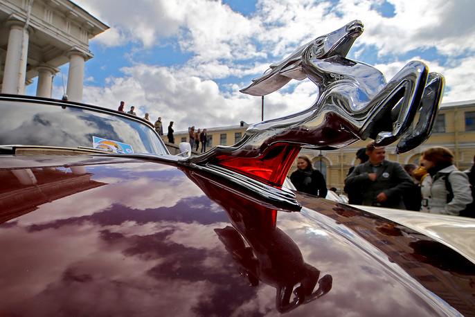 Vintage cars exhibition on the square in front of the stock exchange on Vasilevsky Island in Saint Petersburg