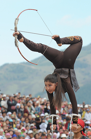 A girl in traditional dress preforming stunts