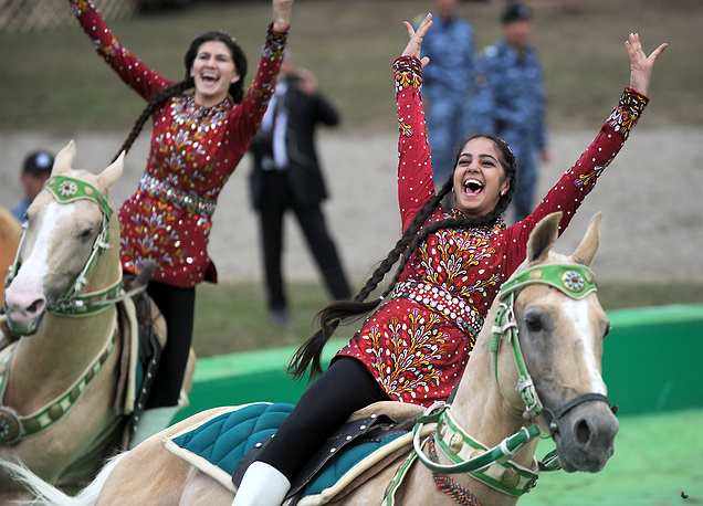 Riders in traditional dress perform stunts on horseback at the the second World Nomad Games