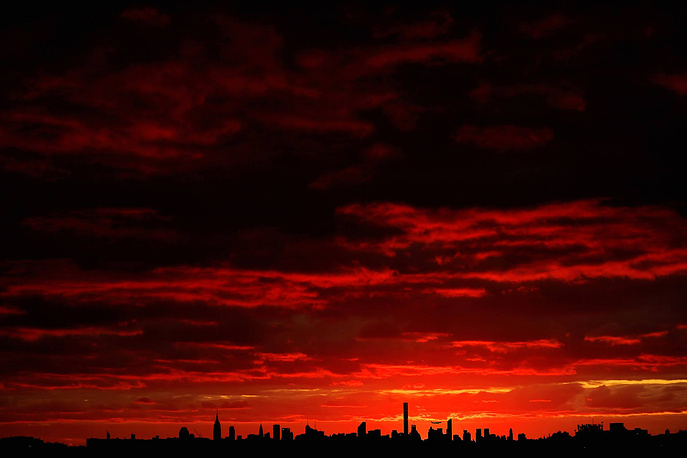 The sun sets over Manhattan, New York, September 6