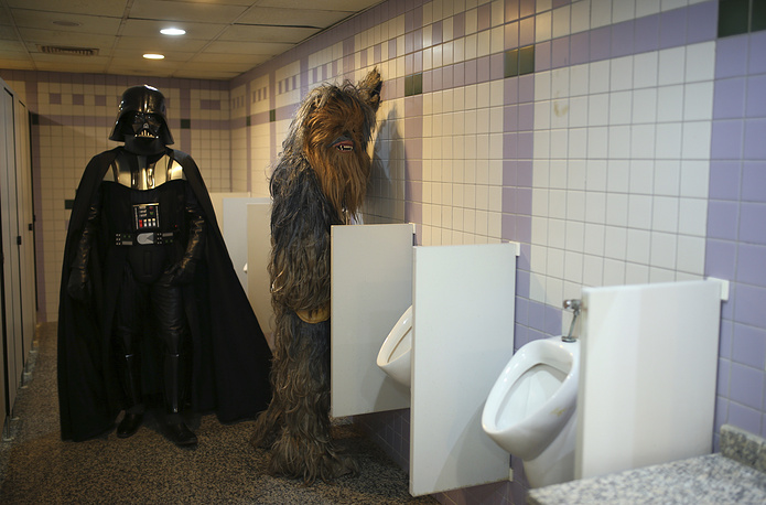 Fans dressed as Darth Vader and Chewbacca in a bathroom at 53rd Antalya Film Festival in Turkey, October 17