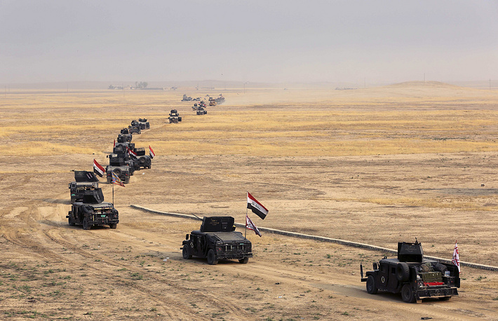 Iraq's elite counterterrorism forces preparing to attack Islamic State positions as fighting to retake the extremist-held city of Mosul enters its second week, in the village of Tob Zawa, outside Mosul