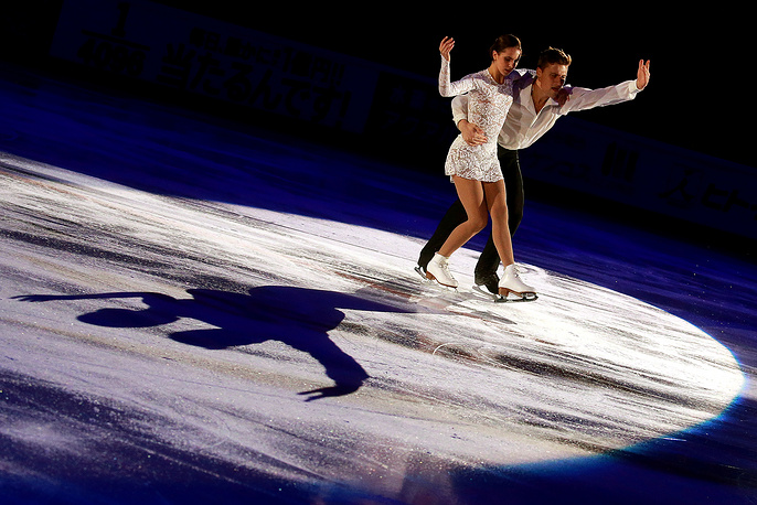 Silver medallists in pair skating Natalia Zabiiako and Alexander Enbert of Russia