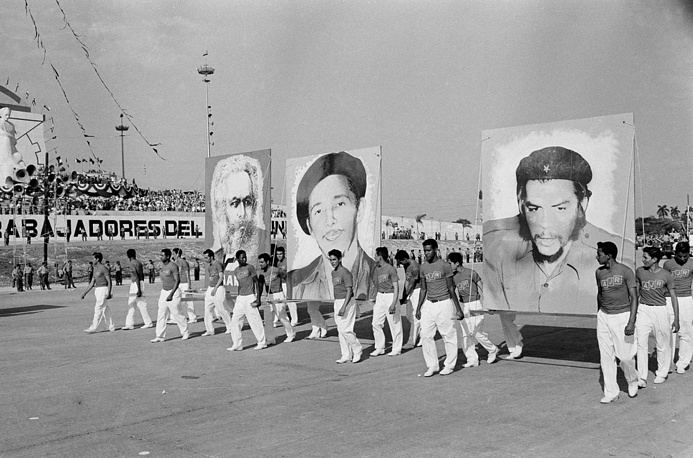 "Years later, on April 16, 1961 Fidel Castro officially declared the socialist nature of Cuban Revolution. Photo: Cuban athletes carrying portraits of Karl Marx, Raul Castro, and Ernest ""Che"" Guevara, during May Day parade in Havana, May 1, 1961"