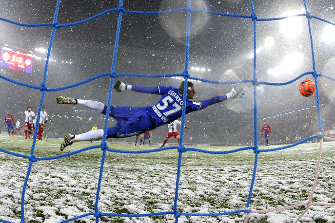 Amkar Perm's goalkeeper Alexander Selikhov concedes a goal in their 2016/17 Season Russian Premier League Round 13 football match, Mocow, November 6