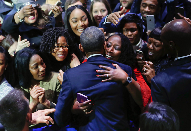 Barack Obama embraced by a woman in the crowd after his farewell address in Chicago, USA, January 10