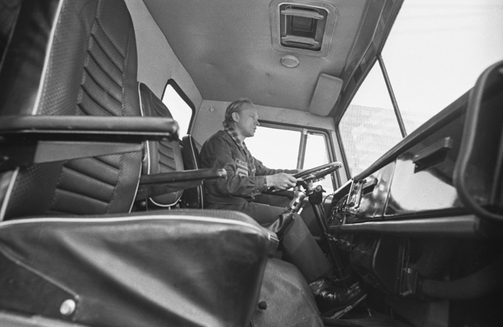 Test driver seen during a trip in a triple cabin of KAMAZ truck, 1976