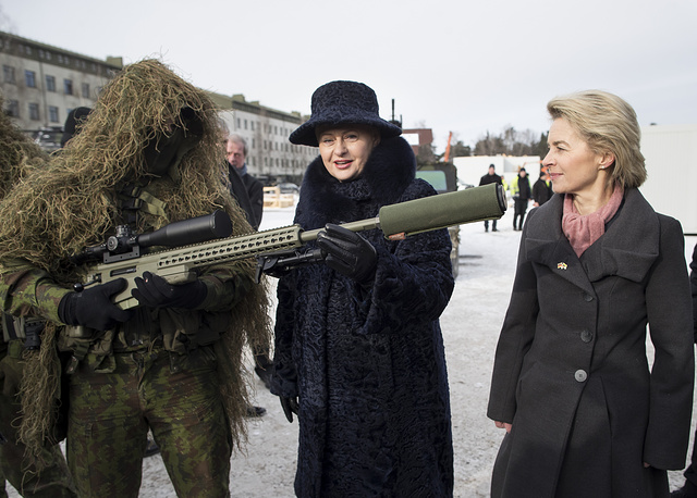 German Defense Minister Ursula von der Leyen and Lithuania's Presidend Dalia Grybauskaite speaks with a soldier during the NATO enhanced forward presence battalion welcome ceremony at the Rukla military base, Lithuania, February 7