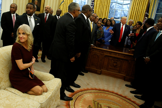 Senior advisor Kellyanne Conway sits on a couch as US President Donald Trump welcomes the leaders of dozens of historically black colleges and universities (HBCU) in the Oval Office at the White House in Washington, US, February 27