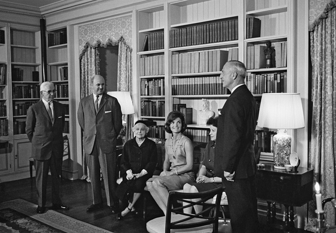 The Kennedy restoration resulted in a more authentic White House of grander stature. Photo: Jacqueline Kennedy poses with officers of the American Institute of Interior Designers at the formal opening of the restored and refurnished White House ground floor library, 1962