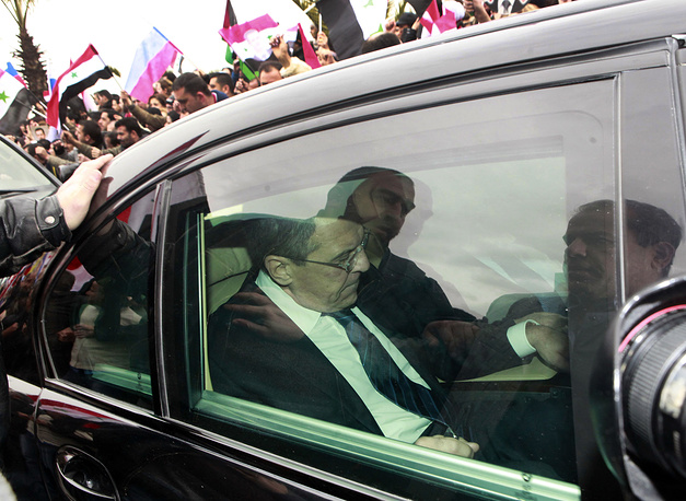 Russian Foreign Minister Segey Lavrov is seen inside a car in Damascus, Syria, 2012