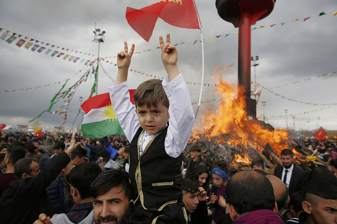 Boy sitting on his father's shoulders to celebrate the recently-permitted festival of Newroz in the ethnic Kurdish city of Diyarbakir, Turkey, March 21