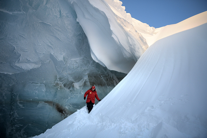 Russian President, Vladimir Putin, inspects a crevasse in a glacier on the Arctic Franz Josef Land archipelago in Arctic Russia, March 29