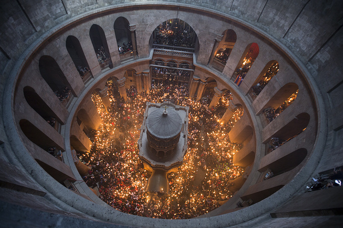 Orthodox Christian worshippers at the Tomb of Christ as the miracle of the Holy Fire ceremony occurs in the Church of the Holy Sepulchre, Jerusalem, Israel, April 15