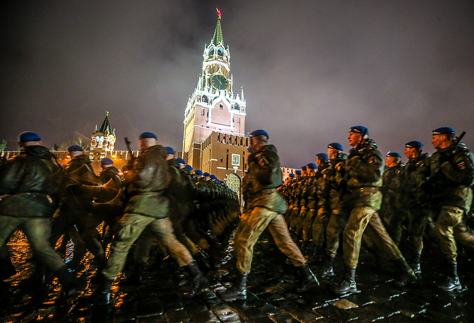 Servicemen march in formation in Moscow's Red Square during a night rehearsal of a Victory Day military parade marking the 72nd anniversary of the USSR's victory over Nazi Germany