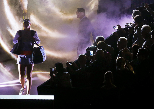 Russia's Maria Sharapova enters the court for her first match after her 15-month doping-related ban at the Porsche Grand Prix in Stuttgart, Germany, April 26