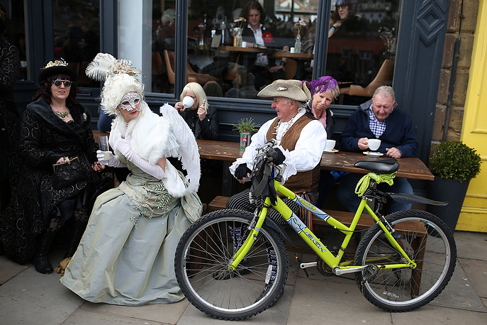 Goths sit outside a bar attending the Goth Festival in Whitby, North Yorkshire, Britain, April 23