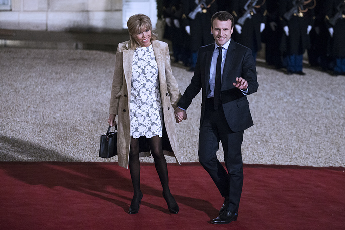 Emmanuel Macron and his wife Brigitte arrive at the Elysee Palace for a state dinner to honor Netherlands' King Willem-Alexander and Queen Maxima's visit in Paris, France, 2016
