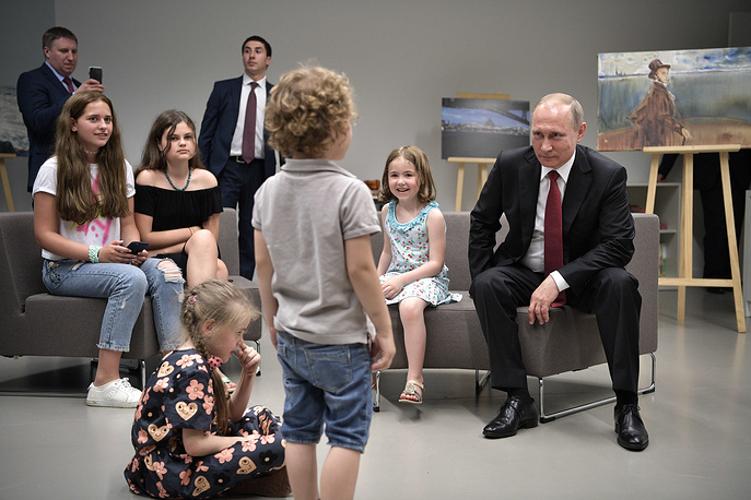Russia's president Vladimir Putin meets with children at the Russian Orthodox Spiritual and Cultural Centre in Paris, France, May 29