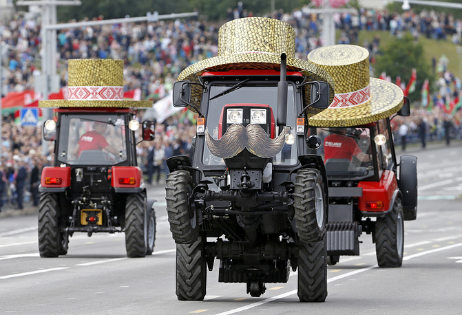 Belarusian tractors perform a ballet dance during a parade marking Independence Day or Day of the Republic celebration in Minsk, Belarus, July 3