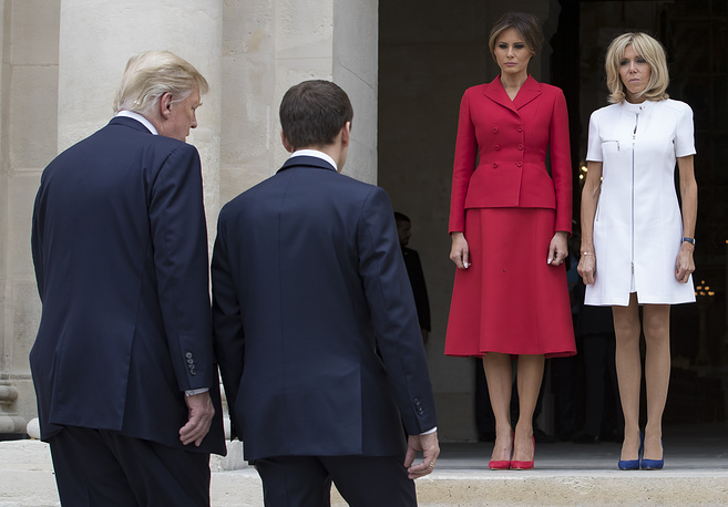 French First Lady Brigitte Macron and US First Lady Melania Trump await French President Emmanuel Macron and US President Donald Trump at Les Invalides museum in Paris, France, July 13