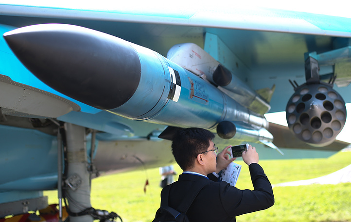 A visitor takes a picture of an aircraft