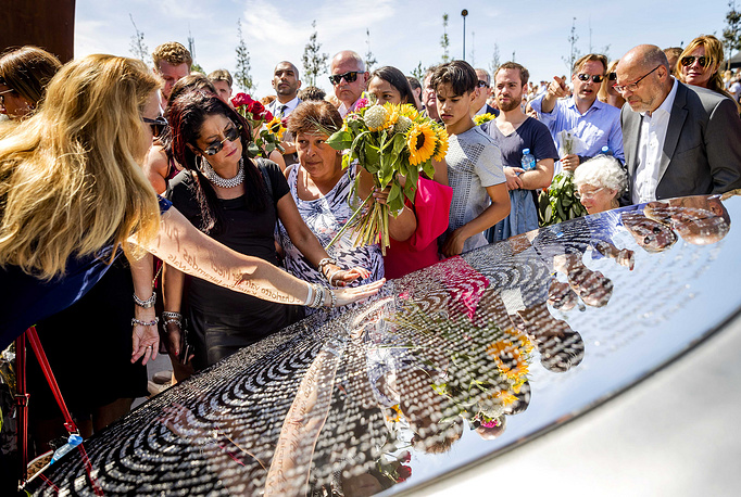 Relatives attend the unveiling ceremony of the National Monument for the MH17 plane crash victims in Vijfhuizen, The Netherlands, July 17