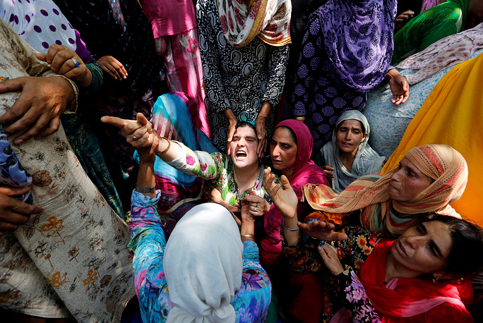 Relatives wail during the funeral of a civilian, who was killed during clashes in Begumbagh, south Kashmir's Pulwama district, India, August 1