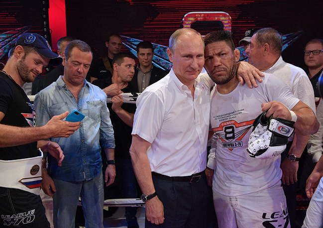 Russia's President Vladimir Putin, Brazil's Luis Sergio Melo Jr. and Russia's Prime Minister Dmitry Medvedev seen after an award ceremony at the Plotforma S-70 international professional combat sambo tournament of League S-70, Sochi, Russia, August 9