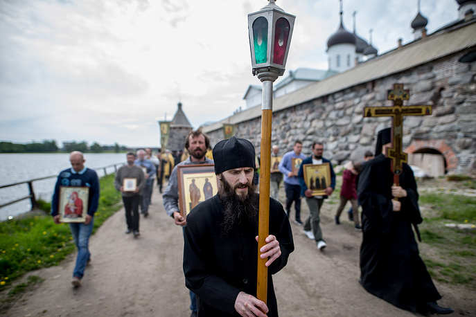 Monks take part in a religious procession at the Solovetsky Monastery