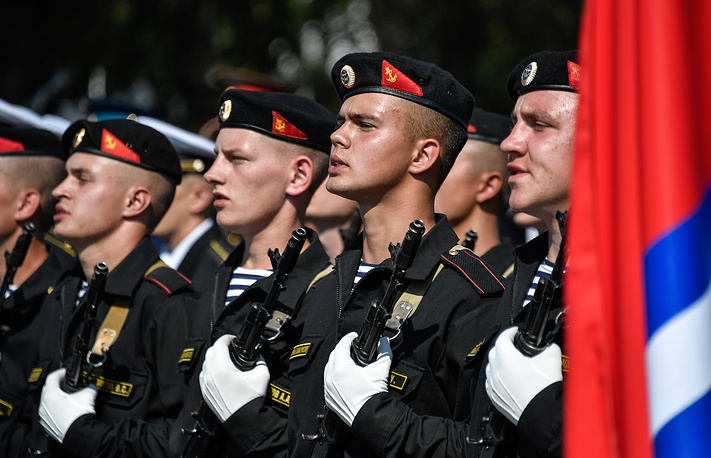 Russian Navy officers at a ceremony to welcome Chinese warships in the port of Vladivostok