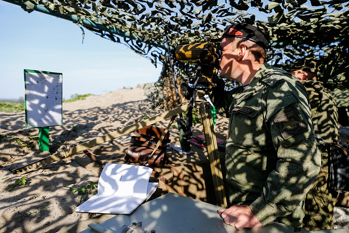 A military officer looks through binoculars during anti-terror drills at Khmelevka range in Kaliningrad region