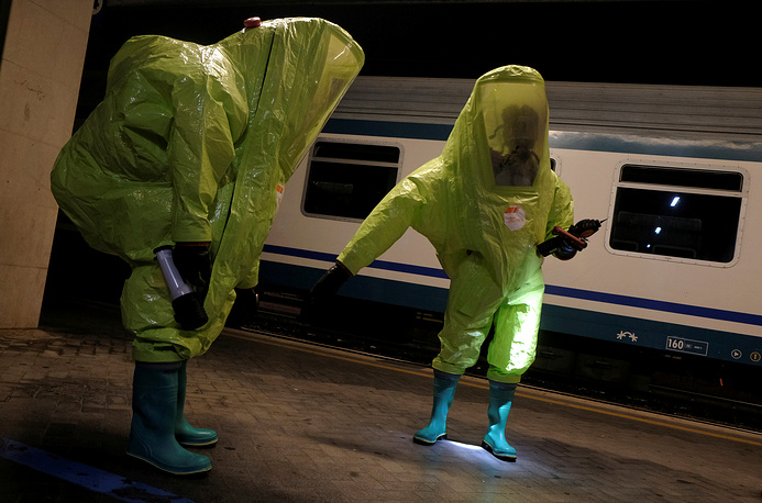 Italian firefighters take part in an anti-terror drill at the Santa Lucia train station in Venice, Italy, October 3