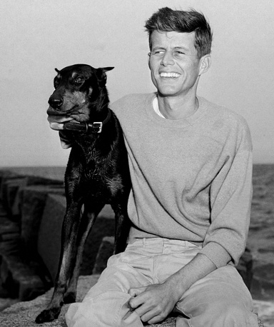 Future 35th President of the United States, John F. Kennedy relaxes with his dog, Mo, in Hyannis Port, USA, 1946