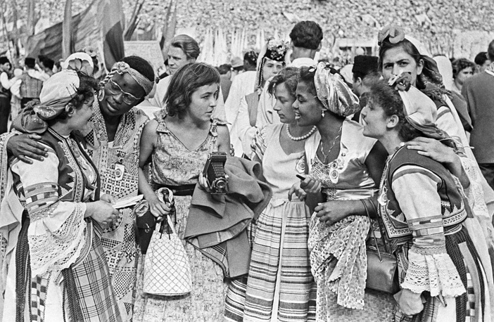 Young people from Africa, Argentina and Bulgaria talking at the official opening of the festival at the Vladimir Lenin Central Stadium in Moscow, 1957