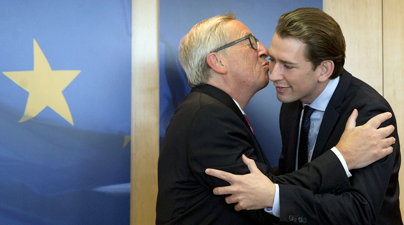 European Commission President Jean-Claude Juncker greets Austrian Foreign Minister Sebastian Kurz prior to a meeting at EU headquarters in Brussels, Belgium, October 19