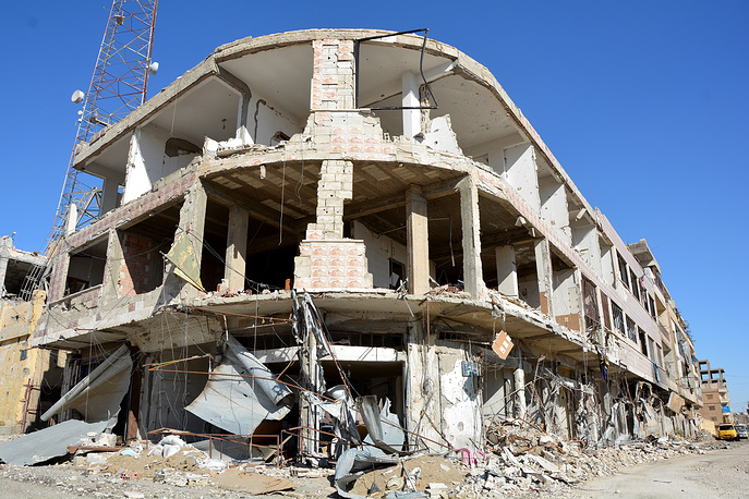 Damaged buildings near the Al-Na'im roundabout in Raqqa