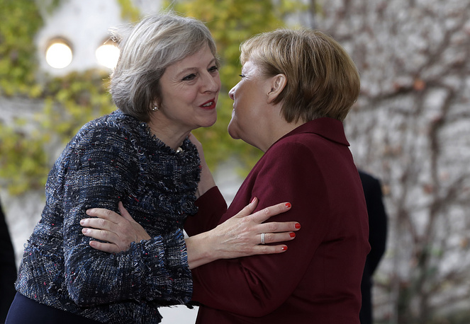 Britain's Prime Minister Theresa May is welcomed by German Chancellor Angela Merkel in Berlin, Germany, 2016
