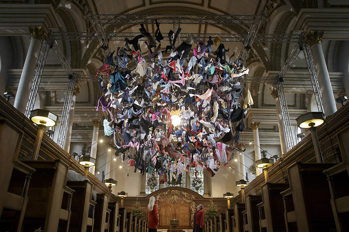 An installation artwork called Suspended, composed of items of clothing discarded by refugees on their arrival at Lesvos, by artist Arabella Dorman, at St James's Church on Piccadilly in London, December 13