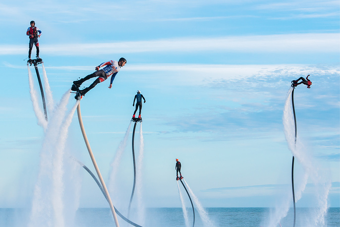 Participants in the Flyboard Record international extreme water sports festival in the Black Sea, Sochi, May 21